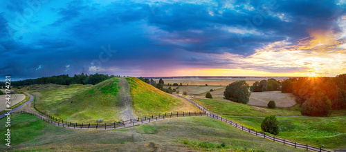 Fotobehang Khaki Sunset over Royal Mounds in Gamla Uppsala, Uppland, Sweden (HDR pnorama)