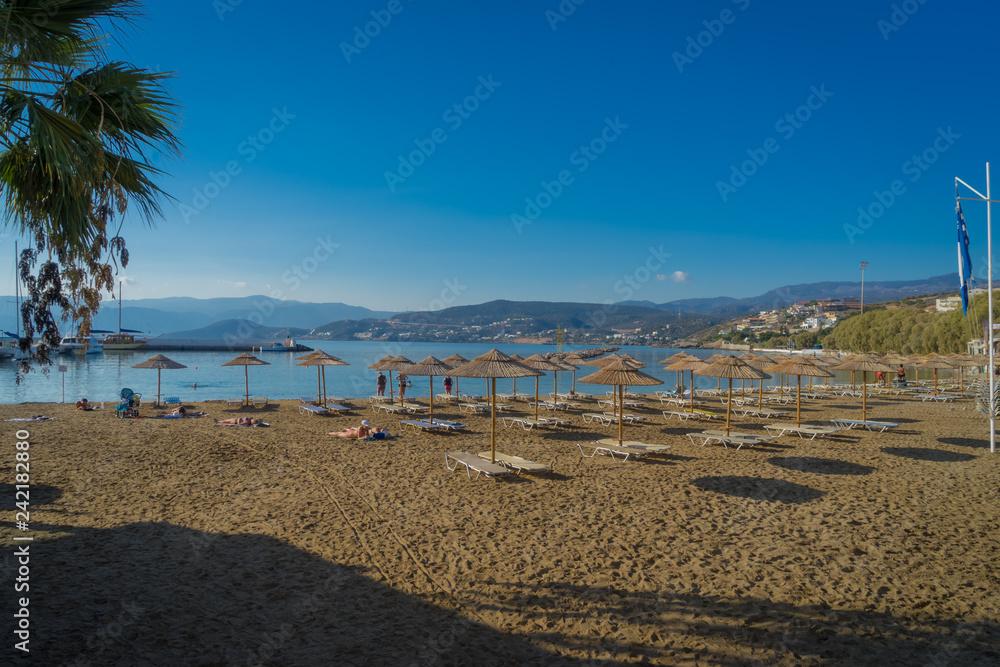 Fototapety, obrazy: Agios Nikolaos, Crete - 10 01 2018: The city of Agios Nikolaos. Parasols on the beach