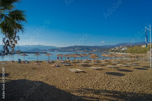 Agios Nikolaos, Crete - 10 01 2018: The city of Agios Nikolaos. Parasols on the beach