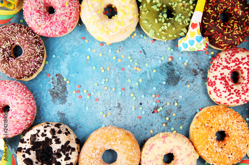Deurstickers Dessert assorted donuts with chocolate frosted, pink glazed and sprinkles donuts