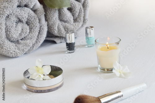 spa setting with towel ,candle and products