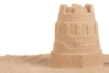 Close Up On A Sand Castle On The Beach, Isolated On White Background. Travel Concept. Copy Space For Your Text Or Image.