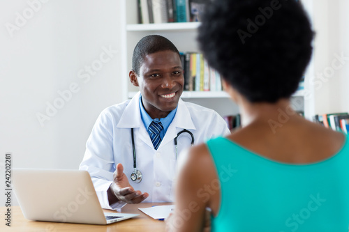 Fotografia  African american doctor with good news for female patient