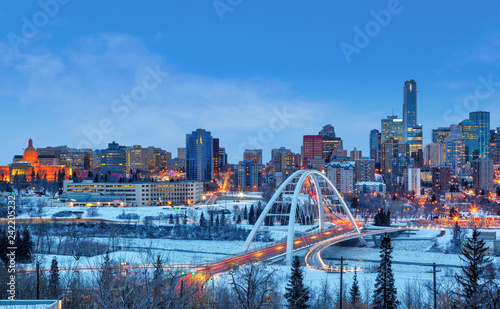 Spoed Fotobehang Centraal-Amerika Landen Edmonton Downtown Skyline Just After Sunset in the Winter Showing Alberta Legislature and Walterdale Bridge Over the frozen Saskatchewan River