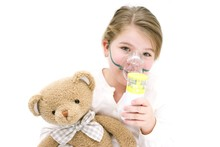 Girl Using Nebuliser Holding T...