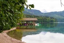 Boathouse In The Mountain Lake