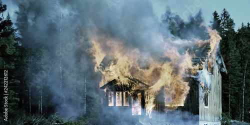 Fotografiet  Panorama view of burning wooden house.