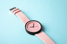 Stylish Wrist Watch On Color Background. Fashion Accessory