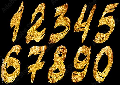 Fotografía  Golden foil ragged arabic numerals on black background