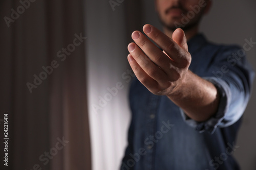Fototapety, obrazy: Man offering helping hand on blurred background, closeup. Space for text