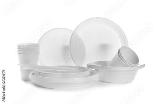 Plastic dishware isolated on white. Picnic table setting