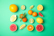 Leinwanddruck Bild - Different citrus fruits on color background, flat lay