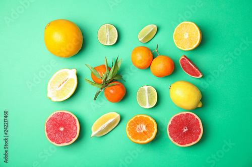 Different citrus fruits on color background, flat lay