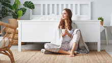Happy Young Woman Having Coffee In Morning In Bed