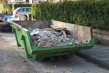 Loaded Garbage Dumpster