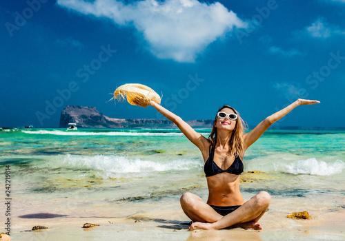 Fényképezés Young redhead girl in black bikini and with hat on Balos beach, west Crete, Greece