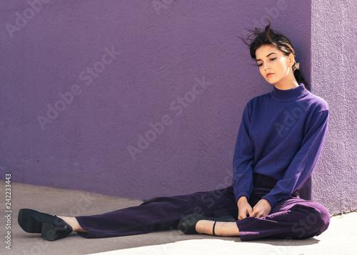 fashionable girl in purple monochrome