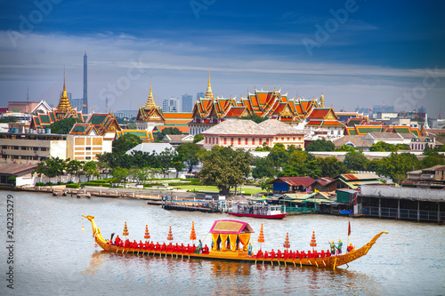 Royal Boat and river with grand palace background in Bangkok city