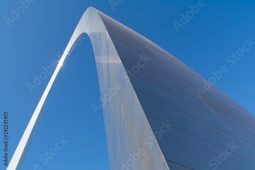 Abstract view of the Gateway Arch with brilliant blue skies in background Wallpaper Mural