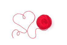 Red Knitting Yarn Isolated On White Background. Top View On Clew With Shape Of Heart.