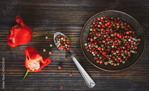 Foto op Canvas Kruiderij Fresh red peppers in the form of a roses, peas of pepper (red, white, green)