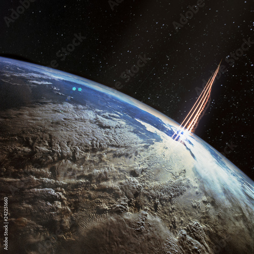 Missile launch, satellite view with planet Earth and galaxy stars. The elements of this image furnished by NASA.