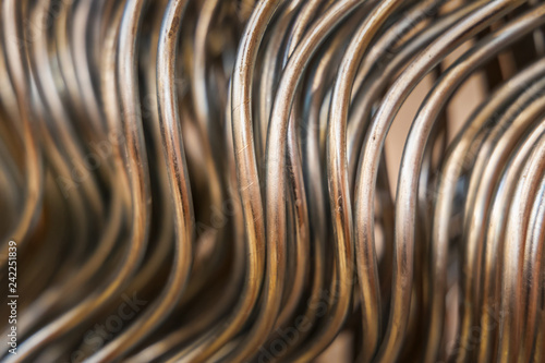Foto  building material - curved rods in silver metal