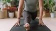 beautiful yoga woman practicing monkey pose meditation enjoying healthy spiritual lifestyle training mindfulness exercise in studio with plants background