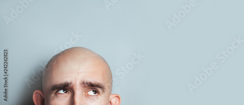 Fotografia, Obraz Emotional portrait of surprised bald man