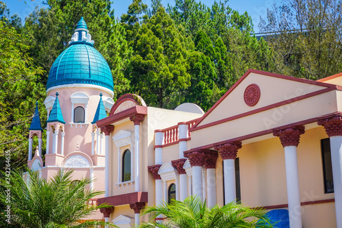 Fotografia  a european style building miniature with blue sky in indonesia with green tree