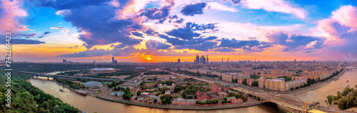 Fotografie, Obraz  Wde angle vibrant panoramic view of sunset above Moscow city and cloud reflectio