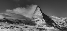 A Wonderful Panoramic Black And White Image Of The North Face Of The World Famous Matterhorn Partly Covered In Clouds On In The Ski Area Of Zermatt In The Swiss Alps