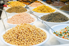 Variety Of Different Types Of Cooked Beans, Lentil And Peas Sold On Food Market In Barcelona In Bowls