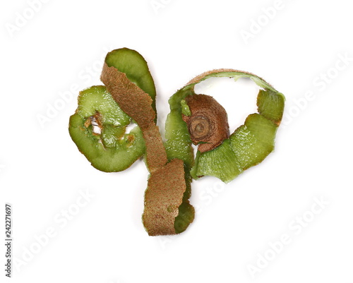 Peeled kiwi fruit skin isolated on white background