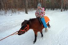 Little Cute Girl Riding A Litt...