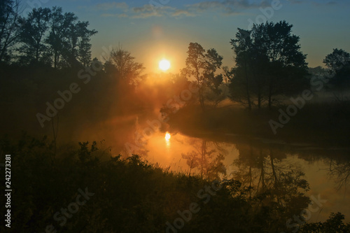 Fotografering  amazing morning landscape with sunrise and fog on the river with forest around