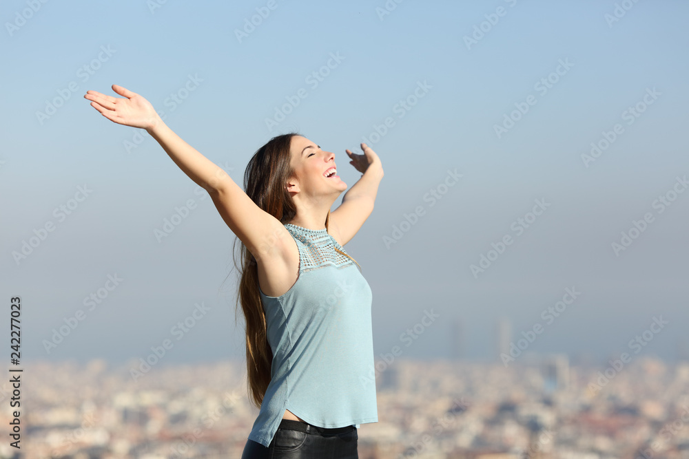 Fototapety, obrazy: Excited woman raising arms celebrating vacation