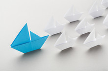 Blue Paper Boat Leading Among ...