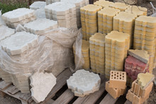 Paving Slabs. Set Of Paving Tiles For Laying. Stone Parquet Sidewalk Paving Stones. Stack Of Concrete Brick.