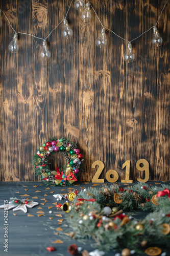 Printed kitchen splashbacks Reflection Christmas wreath with gold numbers 2019 on a wooden dark background