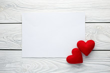 Blank Paper Message With Two Red Love Hearts On White Wooden Background