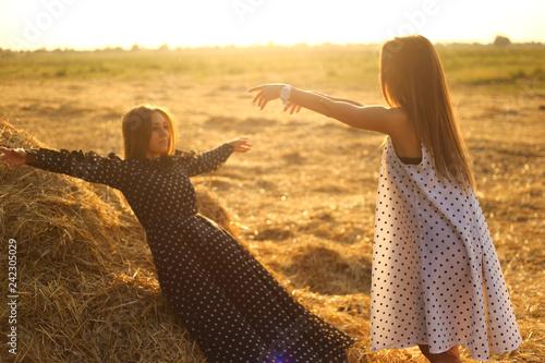 Fototapeta models photo on sunset in hayloft  obraz na płótnie