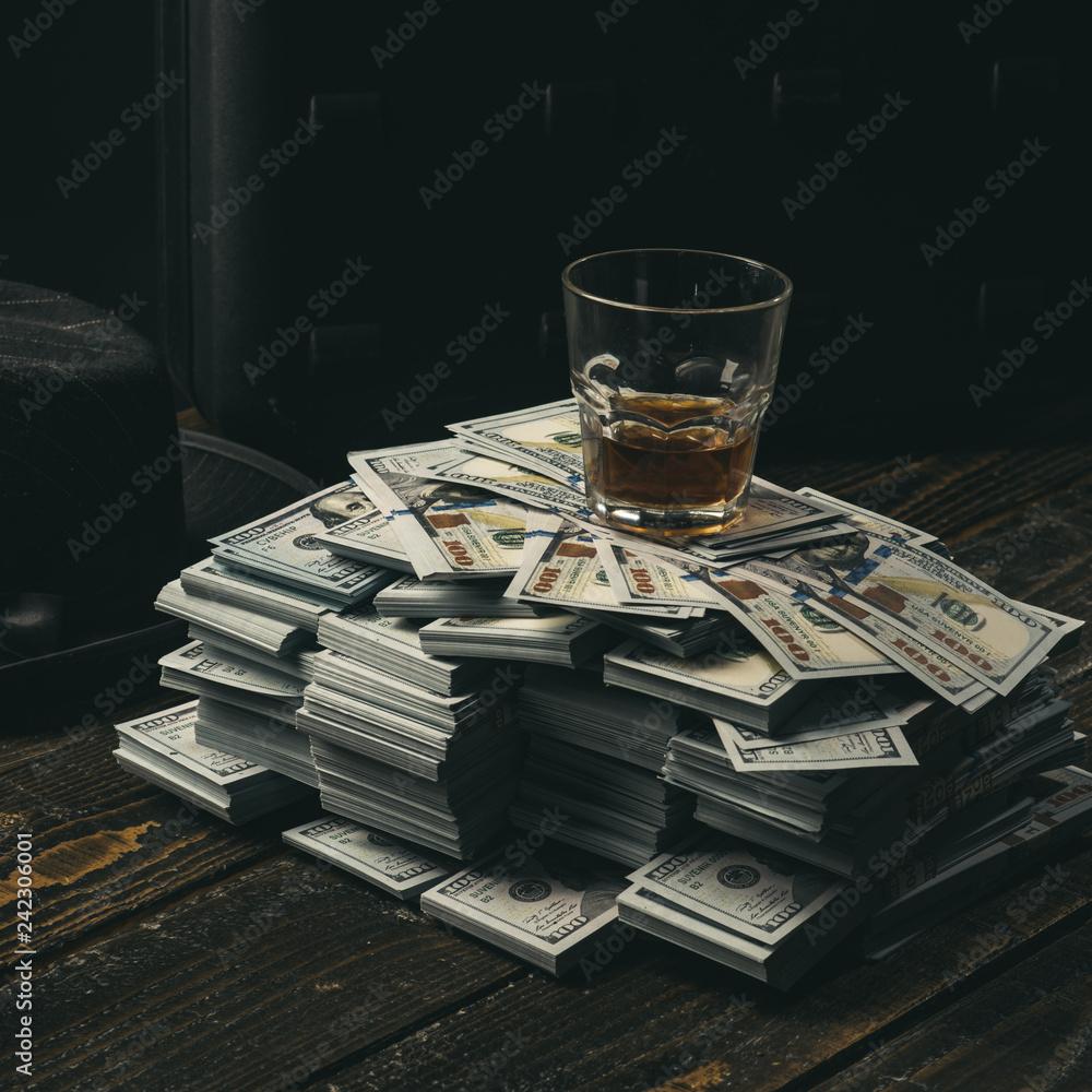 Fototapeta Money transaction. Casino. accountant office. Economy and finance. bookkeeper. Heap of money and alcoholic drink. Mafia. Making money. Small business concept. Mafia is not sleeping