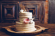 canvas print picture - Rustic style wedding cake with cotton and floral decoration.