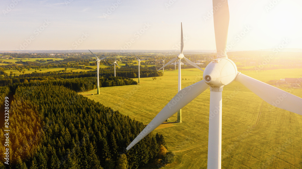 Fototapety, obrazy: Wind turbines and agricultural fields on a summer day - Energy Production with clean and Renewable Energy - aerial shot, analog image style