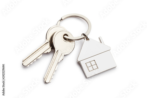 Photo House keys with house shaped keychain, isolated on white background