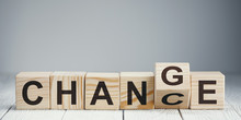 "Wooden Blocks With Letters Forming Words ""Chance"" And ""Change"" On Neutral Background"