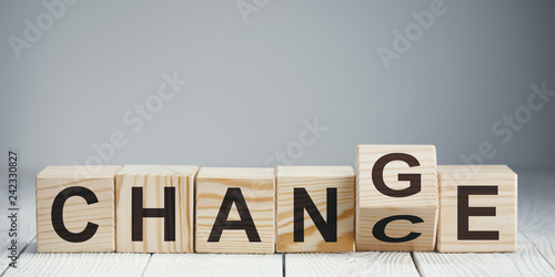 Photographie  Wooden blocks with letters forming words Chance and Change on neutral backgr