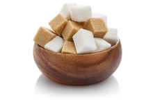 White And Brown Sugar Cubes In A Brown Wooden Bowl, Isolated On White Background