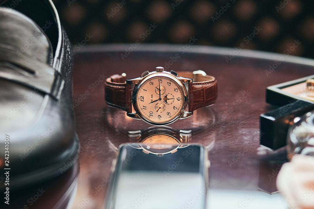 Fototapeta different accessories of a businessman for creating a style of a people lie on a wooden background